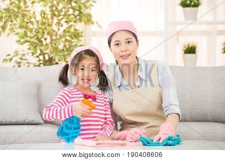 Daughter And Mother Cleaning Together