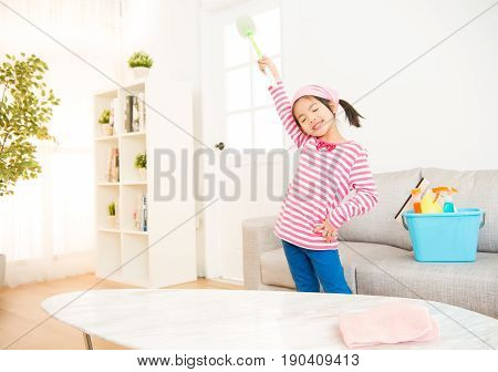 Clean Girl Having Fun During Spring Cleaning