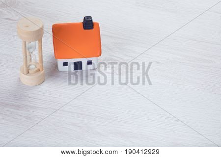 Small Model House With A Wooden Egg Timer