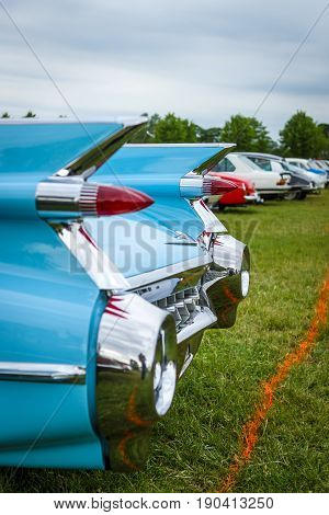 PAAREN IM GLIEN GERMANY - JUNE 03 2017: Rear stoplights of a full-size luxury car Cadillac Coupe DeVille 1959 (focus in the background) Exhibition