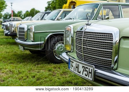 PAAREN IM GLIEN GERMANY - JUNE 03 2017: Various retro cars Mercedes-Benz stand in a row. Focus on the foreground. Exhibition