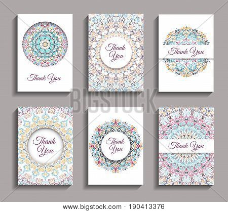 Vector Invitations set. Mandala design elements. Invite templates A6. Colorful round ornaments. Flower greeting cards, thank you notes. Weave floral pattern. Unusual yellow pink blue backgrounds.
