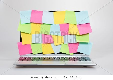 Colorful Sticky Memos Covering A Laptop Screen