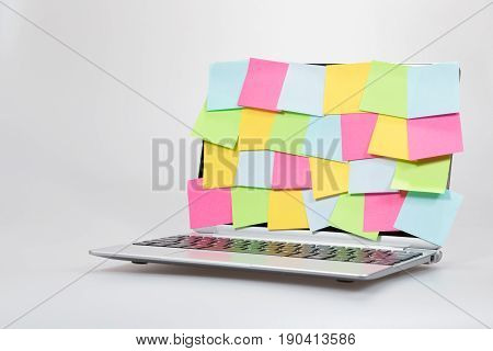 Colorful Blank Paper Memos Stuck To A Laptop