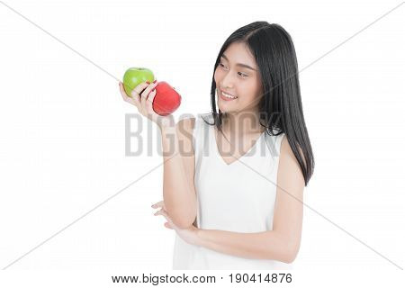 Smiling Asian woman with healthy teen holding red and green apples. white undershirt. isolated portrait.
