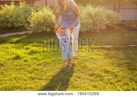 First steps with mother's help in the garden