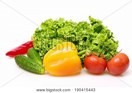 Peppers, Leafy Vegetables Or Lettuce Leaf With Tomatoes And Cucumber