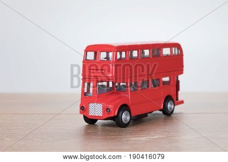 Small Red Toy Bus Over White Background