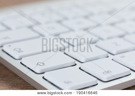 Close-up View Of Keyboard On Top Of Wooden Table