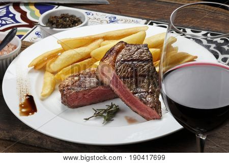 fries with Brazilian picanha and red wine