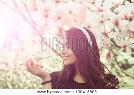 Woman Smiling With Cute, Bunny Ears At Magnolia Tree
