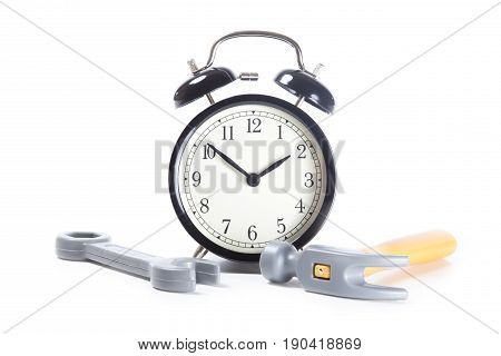 Front View Of Alarm Clock And Toy Tools