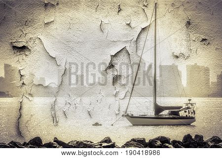 A weathered wall with the image of a sailboat in San Diego CA.