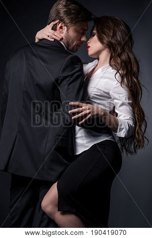 Young Sensual Couple In Love Embracing And Able To Kiss In Erotic Scene