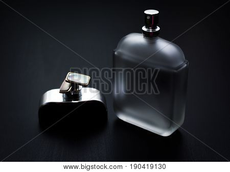 Mens accessories. perfume and cuff in grey background