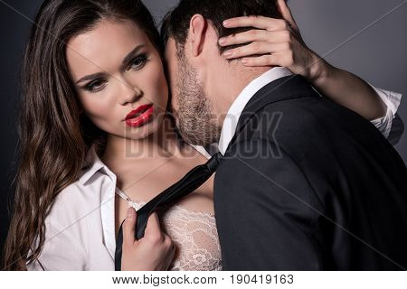 Young Passionate Couple Kissing And Hugging In Erotic Scene