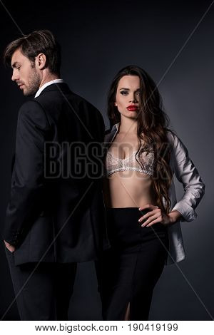 Young Sexy Woman Standing With Her Boyfriend In Formal Wear