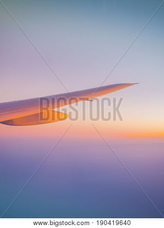 Beautiful dramatic sunset sky when see through the airplane window