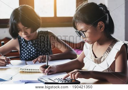 two children business accounting financial suppose in this image