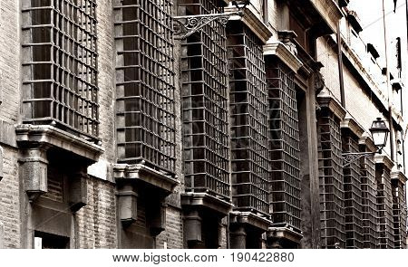 Rome, Italy - April 15, 2017: Close up detail,windows in the lattice of Rome city, Italy