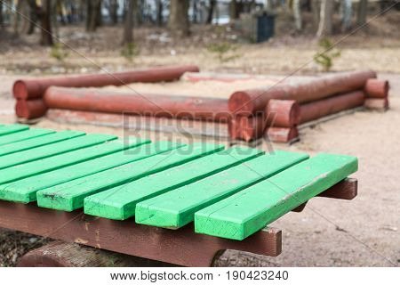 Old Green Wooden Bench And A Sand Pit