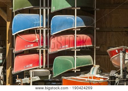 Dartmouth Massachusetts USA - April 11 2007: Canoes stacked on trailer at Lloyd Center in Dartmouth Massachusetts