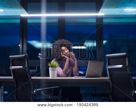 Young african american female Entrepreneur Freelancer Working Using A Laptop In Coworking space
