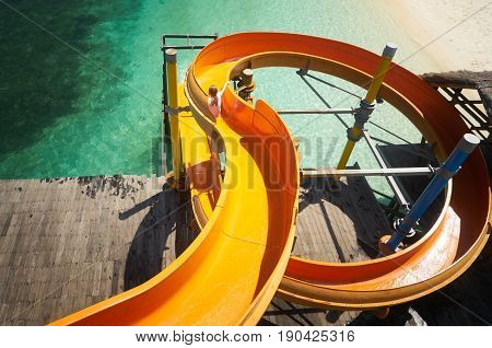 Beautiful tropical beach with waterslide playground on jetty .Rawa island Malaysia .