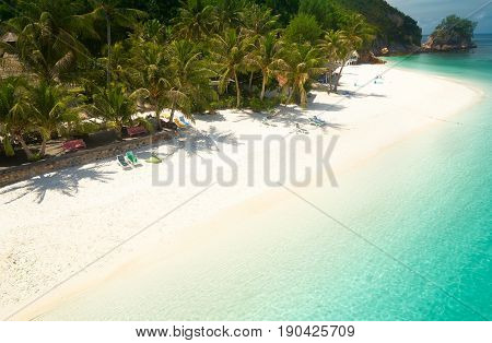 Beautiful beach aerial view over a Rawa island. White sandy beach seen from above. Malaysia .
