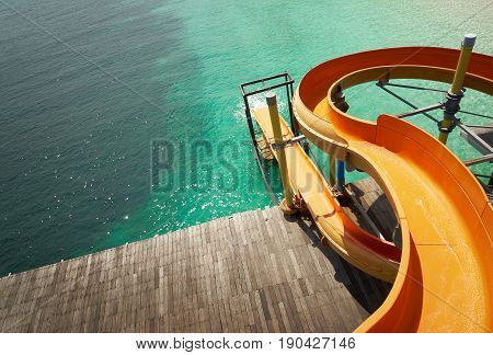 Waterslide on the beach with white sandy and crystal water seen from above. Rawa island Malaysia .