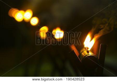 Malay tradition oil lamp or pelita selective focus during Hari Raya celebration.