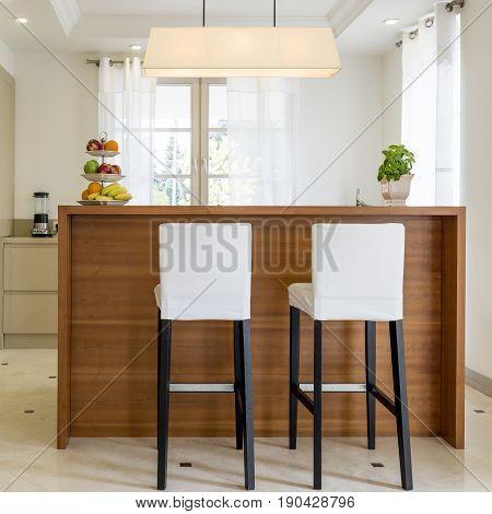 Chairs Standing Beside Kitchen Worktop
