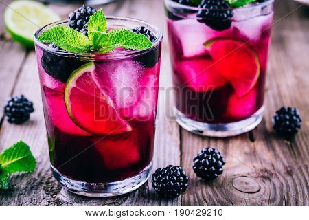 Blackberry Smash  Cocktail  With Lime, And Mint