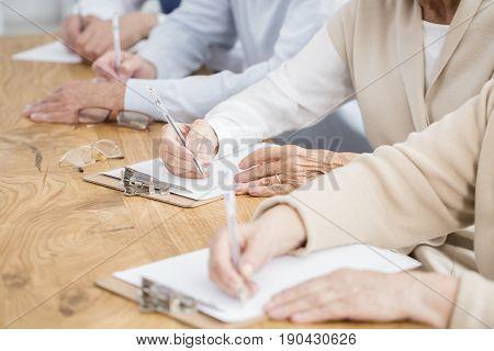 Seniors Making Notes