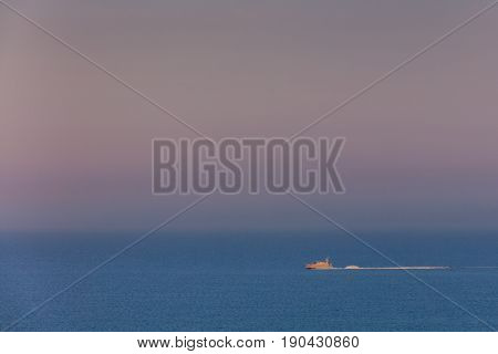 boat on sea at sunset. Livorno Italy