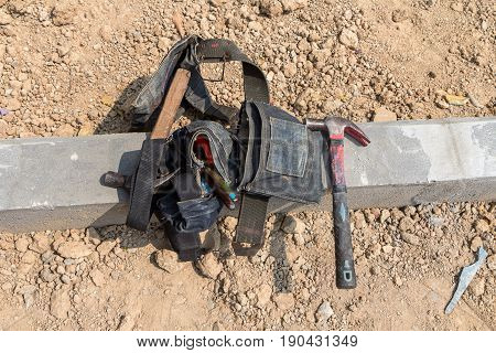 Hammer and work tools in tool belt