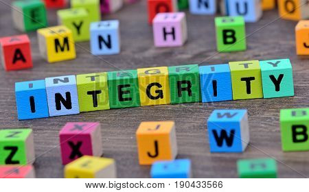 Integrity word on wooden table close up