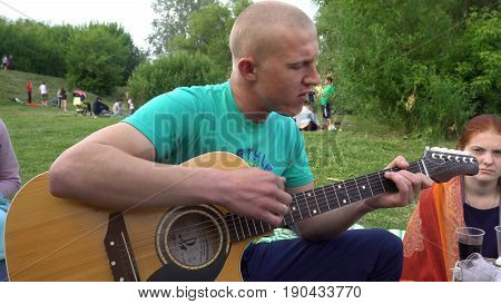 Kursk, Russia - June 4, 2017: Man lead guitarist playing guitar