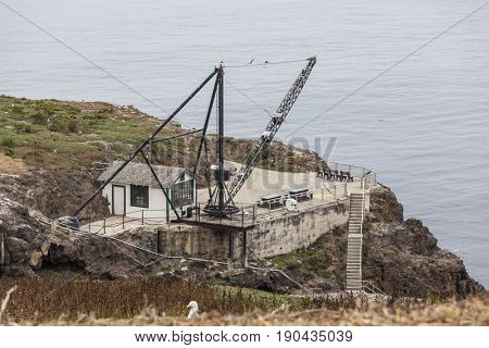 Old crane and support building at Anacapa Island in Channel Islands National Park in Southern California.