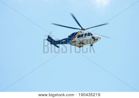 ATLANTIC CITY, NJ - AUGUST 17: NJ State Police Trooper Helicopter performing at Annual Atlantic City Air Show on August 17, 2016