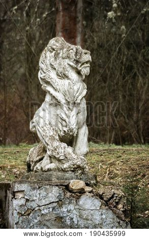Sculpture of a lion in an old noble manor. Selo Ivanovskoye, Russia.