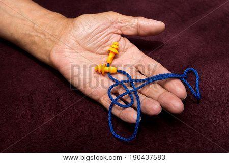 Earplugs In The Hands Of An Elderly Man.