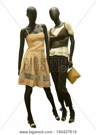 Two full-length female mannequins dressed in fashionable clothes isolated on white background. No brand names or copyright objects.