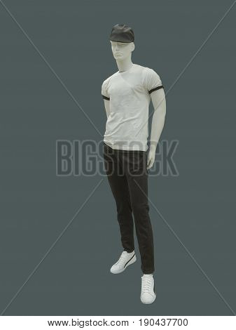 Full-length man mannequin dressed in casual clothes isolated on gray background. No brand names or copyright objects.