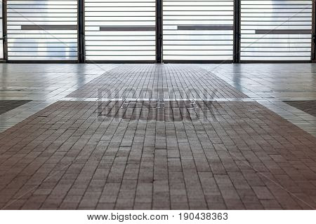 Tiled Floor With Backlit Barred Door