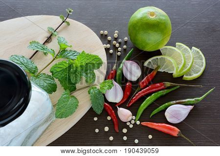 Asian cuisine ingredients food top view spice lemon onion garlic chili pepper mint salt for cooking original eastern foods style on top wood texture background Thailand food spices