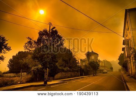 Smoke from a wildfire in a village in Northern Spain