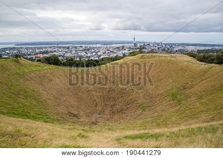 The crater of Mount Eden with Auckland in the background in New Zealand