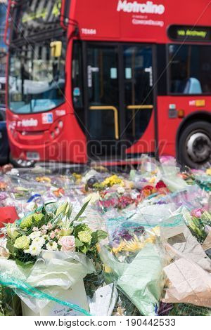 London, UK - 7 June 2017: Floral tributes laid on London Bridge as a memorial to the victims of the terrorist attack that to place in the area on 4th June 2017.