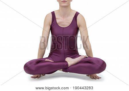 Woman practicing yoga Ardha Padmasana pose isolated on the white background
